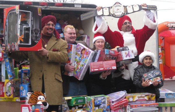 Troy's Toy Drive truck with Tiger Jeet Singh and Tiger Ali Singh